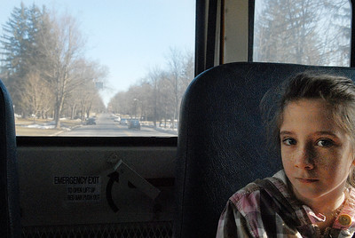 Lake Ave Elementary School student Mary Roe, 9 years old, sits in the back of the school bus waiting to go to school as they head down North Broadway Wednesday morning. The Cornell University Cooperative Extension of Saratoga County and the Saratoga Springs Police Department participated Wednesday in Operation Safe Stop Day, a national event during which police officers ride on school buses and follow in marked and unmarked patrol units to crackdown on illegal school bus passing violations. Photo Erica Miller 3/30/11 news_SchoolBus5_Thurs