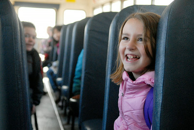 Lake Ave Elementary School student Sakarah Gilboy,7 years old, sits on her school bus waiting to go to school Wednesday morning. The Cornell University Cooperative Extension of Saratoga County and the Saratoga Springs Police Department participated Wednesday in Operation Safe Stop Day, a national event during which police officers ride on school buses and follow in marked and unmarked patrol units to crackdown on illegal school bus passing violations. Photo Erica Miller 3/30/11 news_SchoolBus1_Thurs