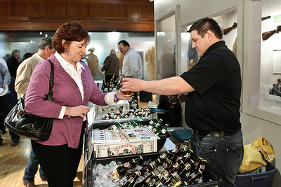 Joe Jaquez of Olde Saratoga Brewing Co. serves up a cold draught to Denise Sheehan during the Night at the Brewseum, a wine and beer tasting sponsored by the NYS Military Museum and the Saratoga Lions Club. Photo Eric Jenks 3/30/12