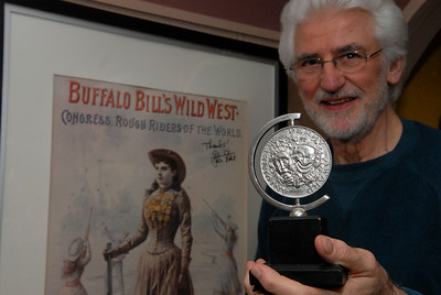 Ron Holgate stands in front of one of his posters in his home holding his Tony Award in Saratoga Springs. Ron is well known in theatrical circles with his stage work. Photo Erica Miller 3/30/12 fea_Holgate4_Sun