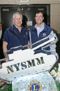 Lance Ingmire, President of the Friends of the NYS Military Museum and Chuck Eafrato, President of the Saratoga Springs Lion Club pose for a photo during the Night at the Brewseum; a wine and beer tasting benefit Friday evening. Photo Eric Jenks 3/30/12