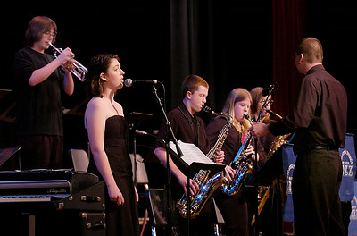 Kate Bullock sings as the High School Jazz Combo backs her up under the direction of Milt Lee during Wednesday's All Jazz Night at Saratoga Springs High School. Ed Burke 5/27/09