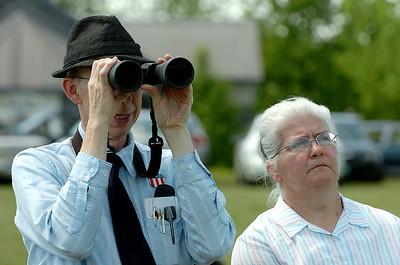 George McCleery and wife Cheryl of Edinburgh  watch Mondays Memorial Day ceremony Monday afternoon at the Saratoga National Cemetery. photo Rick Gargiulo news_memday5_tue 5/25/09