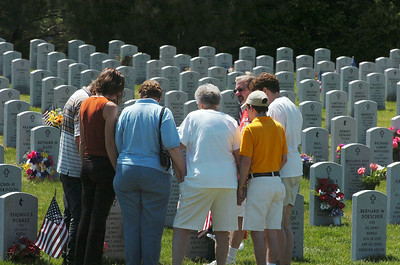 Loved-ones gather around a grave-site at the Saratoga National Cemetery Monday Memorial Day. photo Rick Gargiulo news_memday1_tue 5/25/09