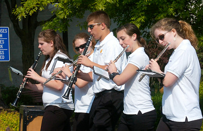 Members of the Ballston Spa High School Band break into a short refrain of Yankee Doodle as they march Saturday in the village's Memorial Day Parade. Ed Burke 5/23/09