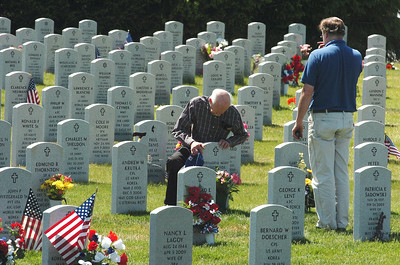 World War II veteran Albert Casagrande ,left and son Bob both of Queensbury ,  pay respects to Bernadine,  wife and mother, during Memorial Day at the Saratoga National Cemetery. photo Rick Gargiulo  news_memday2_tue 5/25/09