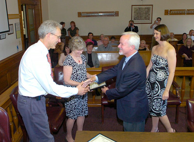 Saratoga Springs mayor Scott Johnson congratulates Dr. John Koella and Dr. Susan Sharp on receiving an award from the Saratoga Springs Preservation Foundation for building a garage that was appropriate in size and design for their Court St. neighborhood. The foundation recognized the 2009 recipients during a ceremony Thursday at city hall. Samantha Bosshart, executive director of the foundation is at right. Ed Burke 5/21/09
