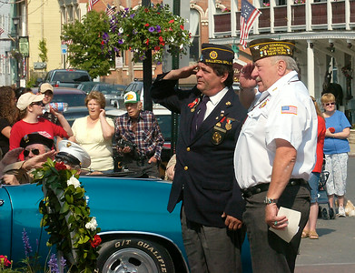 American Legion Post 234 commander Lew Jenison, left, and VFW Post 358 commander Bob Starks salute after placing a wreath at the Civil War Memorial during Saturday's Memorial Day parade in Ballston Spa. Ed Burke 5/23/09