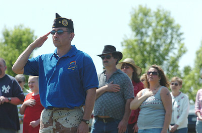 Richard Goldenberg,left, of Schuylerville and a member of the Jewish War Veterans Albany Post 105 and a U.S. veteran of the war in Iraq stands at attention during Monday afternoons Memorial Day ceremony at the Saratoga National Cemetery. photo Rick Gargiulo news_memday4_tue 5/25/09