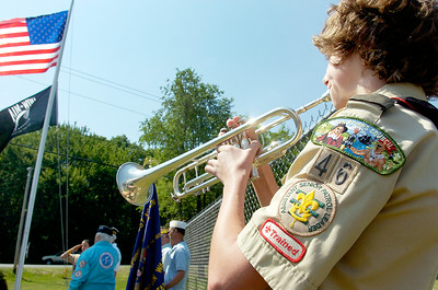 Boy Scout Brandon Stites plays the TAPs on his trumpet for the flag raising by Eagle Scout candidate Schuyler Mangino at the Geyser Road Veteran's Memorial Park for building a raised garden, planting schrubs and perennial flowers and installed a flag poll and benches. Photo Erica Miller 5/31/10 news_Mangino2_Tues