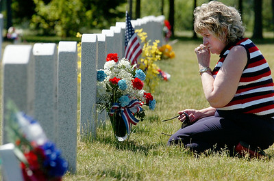 Ella McDougall, of Broadalbin, wipes a tear from her face at the grave site of Theodoree McDougall III SSG US Army after the 11th Annual Memorial Day Ceremony at the Gerald B.H. Solomon Saratoga National Cemetery. Photo Erica Miller 5/31/10 news_SarNtlCem2_Tues
