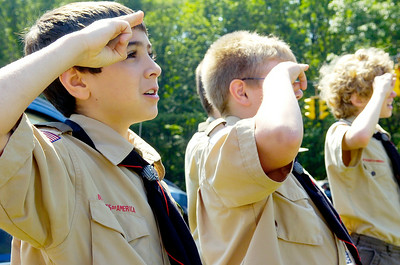Saratoga Boy Scout Alex Verhaeg, 10, salutes the flag reciting the Pledge of Allegiance with Eagle Scout candidate Schuyler Mangino at the Geyser Road Veteran's Memorial Park for building a raised garden, planting schrubs and perennial flowers and installed a flag poll and benches. Photo Erica Miller 5/31/10 news_Mangino1_Tues