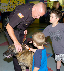 Saratoga County Sheriff's Department deputy Mike Traylor and his K-9 partner Koda greet Tyler, right, and Brett Terrien of Poultney, Vermont during Friday's Take 25 children's safety event at the TreePaad Fun Center in Malta.   Ed Burke 5/28/10