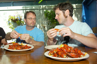 "John Reine (right), of Saratoga originally from New Orleans, enjoys a fresh plate of boiled crawfish with friend Brent Erickson, of Albany, for Hattie's Annual Crawfish festival to benefit Caffe Lena Sunday afternoon. Reine said ""The crawfish festival is the best thing in Saratoga. Growing up we always had crawfish boils."" Owner Chef Jasper Alexander flew in more than 300 pounds of crawfish for the event. Photo Erica Miller 5/30/10 news_Crawfish2_Mon"