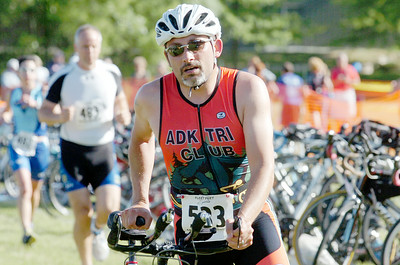 Ronald Richards, of Corinth, grabs his bike after a 5k run for a 20 mile windy bike ride followed by another 5k run for the Saratoga Springs Lions Club 6th Annual Duathlon, finishing 38th, near Skidmore College Sunday morning. Photo Erica Miller 5/30/10 spt_Duathlon3_Mon