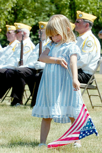 Three year old Kiera Rasmussen, of Schagticoke, waves her American Flag around during the 11th Annual Memorial Day Ceremony at the Gerald B.H. Solomon Saratoga National Cemetery where her grandfather is buried. Photo Erica Miller 5/31/10 news_SarNtlCem1_Tues