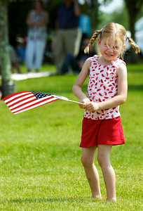 In excitement Kiera Rasmussen, 4 year-old of Schaghticoke, waves her flag in the air at the Saratoga National Cemetery 12th annual Memorial Day ceremony, Kiera's grandfather is also buried in the cemetery which they visited.  Photo Erica Miller 5/30/11 news_MemDay4_Tues