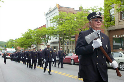 Ax at the ready, Ballston Spa firefighter Charles Koines marches with his department in the village's Memorial Day parade. Ed Burke 5/28/11