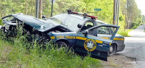 This NYS Trooper sits on the side of the road of Northern Pines Road in Wilton after striking with a Honda Civic near the intersection of Lonesome Pines Trail on Monday afternoon. Photo Erica Miller 5/30/11 news_TrooperAcdt2_Tues