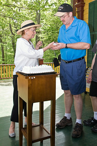 Hady Finch serves up cake at Grant Cottage in Wilton, NY to Stephen Decker Sunday afternoon. Photo Eric Jenks 5/29/11