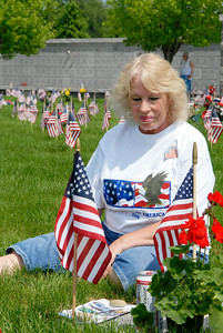 Joyce Rescigno, of Stillwater, sits at her brother Rex Rescigno's, a Vietnam veteran, gravesite as she set it up with his favorite things, including a can of Budweiser, before the Saratoga National Cemetery held their 12th annual Memorial Day ceremony. Photo Erica Miller 5/30/11 news_MemDay1_Tues