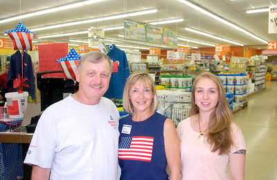 Quality Hardware owner Louise Eddy, right, stands with her parents Bill and Carolyn Eddy. Ed Burke 5/28/11