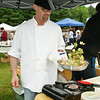 Tony Bifano of Wheatfields fixes up a scrumptious pasta dish for folks to try  during the first Malta Drive In Market Sunday Morning. Photo By Eric Jenks 5/22/11