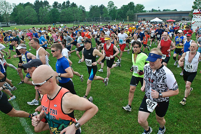 A field of runners take off during the first 5k portion of the 7th annual Duathlon held by the Saratoga Lions Club Sunday morning. Photo By Eric Jenks 5/29/11