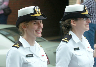 Navy Ensigns Jennifer Noonan, left, and Ravin Brodsky march with other sailors from the West Milton base in Saturday's Ballston Spa Memorial Day parade. Ed Burke 5/28/11