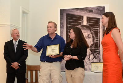 SSPF Executive Director Samantha Bosshart  and Mayor Scott Johnson look on after presenting Nicolo and Patricia Gangi with an award from the Saratoga Springs Preservation Foundation for the work they did on their home at 25 George St. Ed Burke 5/30/13