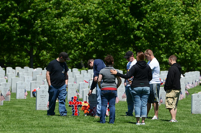 Friends gather around the tombstone of Marine Lance Cpl. Anthony Denier, a Mechanicville resident who was killed Dec.2 by enemy fire 2012, at the Gerald B.H. Solomon Saratoga National Cemetery on Memorial Day after the service held on Monday, honoring all Veterans. Photo Erica Miller 5/27/13 news_Memorial2_Tues