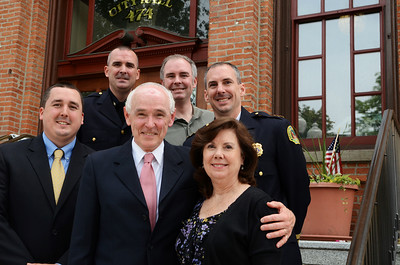 The Veitch Family Tree, mother Gail and Michael Veitch with youngest son Michael. Top row, Paul, Matt and Saratoga Springs Police Chief Greg Veitch. Missing Mary, sister. Photo Erica Miller 5/28/13 news_Veitch6_Wed