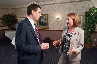 Peter Martin chats with Joanne Yepsen before making his announcement to run for County Supervisor Wednesday afternoon at Lillians in Saratoga Springs, NY. Photo Eric Jenks 5/29/13