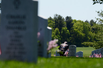 A man takes a moment of silence at a tomb stone at the Gerald B.H. Solomon Saratoga National Cemetery on Memorial Day for their service held on Monday, honoring all Veterans. Photo Erica Miller 5/27/13 news_Memorial1_Tues