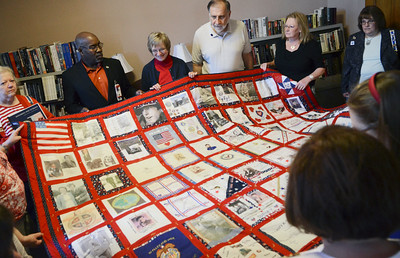 A quilt was presented that will be hung at the Saratoga Military Museum for Veterans, shown to the Daughters of the American Revolution.  Photo Erica Miller 5/27/13 news_DARflag3_Tues