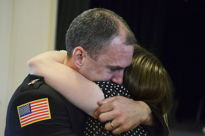 Saratoga Springs Police Chief Greg Veitch was sworn into office, after hugged by wife Jennifer.  Photo Erica Miller 5/28/13 news_Veitch3_Wed