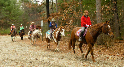 Danielle Stark of Saratoga Springs leads riders and the mounts into the woods at Louden Trail Thursday. Ed Burke 11/26/09