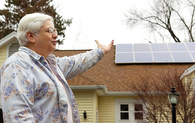 Elayne Leonelli, shows her solar panels that she had installed earlier this year on her house in Glens Falls. Photo Erica Miller 11/27/09 news_Solar2_Sun