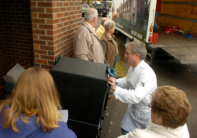 As volunteers gather outside the Presbyterian New England Congregational Church to deliver holiday meals, Steve Sullivan of the Olde Bryan Inn and Longfellows delivers hot food for Thursday's EOC's Community Thanksgiving dinner. Ed Burke 11/26/09