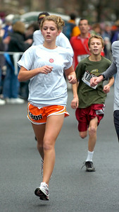 Kerri Wegner of Wilton finishes Thursday's Turkey Trot. Ed Burke 11/26/09