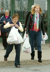 Jackie Liddle, left, and, Samantha Liddle of Argyle leaving the Wilton Mall after Christmas shopping on Black Friday. Photo Erica Miller 11/27/09 news_Shoppers3_Sat