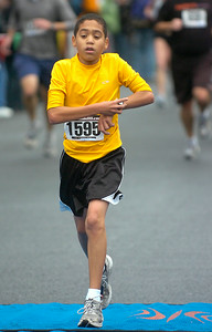 Twelve year old Jaxon Smith of Ballston Spa crosses the finish line in Thursday's Turkey Trot. Ed Burke 11/26/09