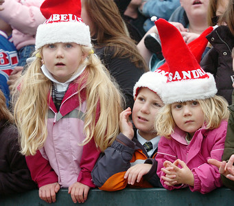 Siblings Isabelle, 5, Justin, 6, and Alessandra, 3, Layre of Malta, stare in  anticipation of Santa Clause to come off the Canadian Pacific Holiday Train to stop at the Saratoga Springs Amtrak Station Monday morning. Photo Erica Miller 11/30/09 news_HolidayTrain1_Tues