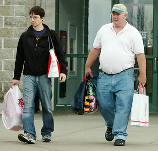 Tim Chapp (left), of Lebanon New Hampshire, and Chris Rohrs, of Gloversville, leave the Wilton Mall after Christmas shopping on Black Friday. Photo Erica Miller 11/27/09 news_Shoppers2_Sat