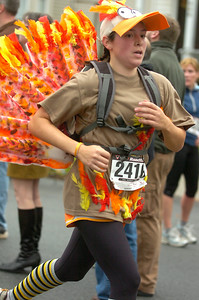 Sheray Michel of Schuylerville trots in her turkey outfit during Thursday's race. Ed Burke 11/26/09