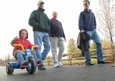 Six year old Zach DeSieno waves to the camera as he explores Spring Run Trail Friday with, from left: his grandfather Bob DeSieno, uncle Robert DeSieno and father Tim. Zach and Tim were visiting Saratoga for Thanksgiving from New York City. Ed Burke 11/26/10