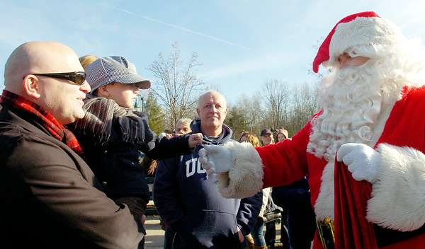 Santa Clause delivers candy canes to Jackson Pitts, 3 years old, with his father David, of Latham, for the Annual CP Holiday Train at the Saratoga Train Station. Photo Erica Miller 11/29/10 news_HolidayTrain1_Tues