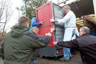 Steve Sullivan wheels crates of Thanksgiving food from The Longfellows / Olde Bryan Inn truck with volunteers into the Presbyterian New England Congregational Church Thursday morning where food was delivered and served. Photo Erica Miller 11/25/10 news_Thanksgiving1_Fri