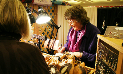 Helen Fuschetto of Mt. Vision sells her handmade jewelery Saturday at the annual craft fair to benefit the Saratoga Center for the Family, at the Saratoga Springs City Center.   Photo by Alexander Spinelli 11/27/10