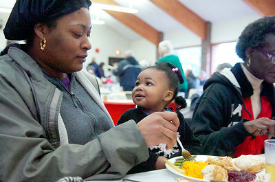 Jalyn Tillman, 1 year old, smiles up at her mother Diamond as they enjoy Thanksgiving dinner at the Presbyterian New England Congregational Church Thursday morning. Photo Erica Miller 11/25/10 news_Thanksgiving6_Fri